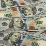 Many one hundred dollar bills — Stock Photo #60441721
