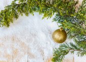 Christmas tree branch and Christmas-tree toy in the snow — Stock Photo