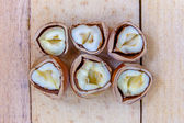 Chopped nuts on wooden boards — Stock Photo