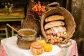 Pumpkin and bread, country cooking, Italy — Stock Photo