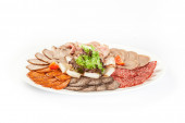 Cutting bacon, sausage and cured meat — Stock Photo