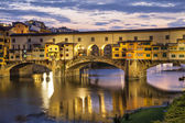 Ponte Vecchio bridge in evening illumination — Stock Photo