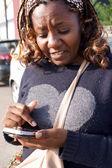 Signora africana texting — Foto Stock