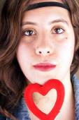 Girl with red heart — Stock Photo