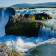 Beautiful vibrant panorama picture with a view on icelandic waterfall in iceland goddafoss gullfoss skogafoss skogarfoss dettifoss seljalandsfoss — Stock Photo #59500185