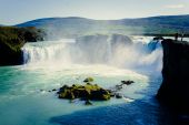 Beautiful vibrant panorama picture with a view on icelandic waterfall in iceland goddafoss gullfoss skogafoss skogarfoss dettifoss seljalandsfoss — Stock Photo