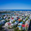 Beautiful super wide-angle aerial view of Reykjavik, Iceland with harbor and skyline mountains and scenery beyond the city, seen from the observation tower of Hallgrimskirkja Cathedral. — Stock Photo #61778973
