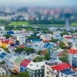 Beautiful super wide-angle aerial view of Reykjavik, Iceland with harbor and skyline mountains and scenery beyond the city, seen from the observation tower of Hallgrimskirkja Cathedral. — Stock Photo #61779677