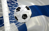 Vlag van Finland en voetbal bal in doel netto — Stockfoto