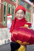 Boy holding red lantern in Courtyard — Stock Photo