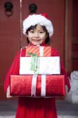 Girl Holding Christmas Gifts — Stock Photo