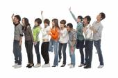 Group of young people waiting in line — Stock Photo