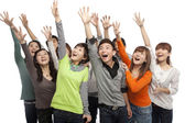 Group of young people looking up in excitement — Stock Photo