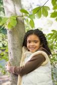 Girl holding a tree — Stock Photo