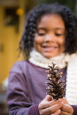 Girl with a pine cone — Stock Photo
