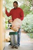 Father and son with groceries — Stock Photo