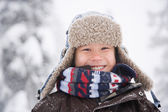 Portrait of the Boy in the snow — Stock Photo