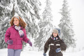 Children in the snowy forest — Stock Photo