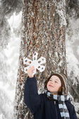 Boy with a snowflake — Stock Photo