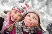 Girls in the snowy forest — Stock Photo