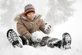 Boy sitting in the snow — Stock Photo