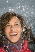 Woman laughing in the snow — Stock Photo