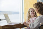 Mother and daughter working at the computer — Stock Photo