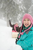 Mother and daughter with toboggan — Stock Photo