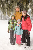 Family in the snow forest — Stock Photo