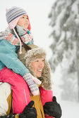 Father and daughter in snow — Stock Photo