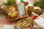 Money present in a wooden box for New Year's Day — Stock Photo