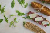 Sandwiches with rucola,parmesan cheese,bresaola. — Stock Photo