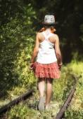 Teenage girl is walking away by the rainlings — Stock Photo