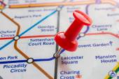 Thumbtack on Leicester Square station in london underground map — Stock Photo