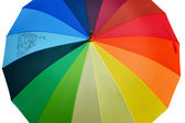 Umbrella with rainbow colors isolated on white — Stock Photo