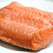 Big piece of salmon fillet on a white plate — Stock Photo #53556223