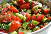 Tasty vegetarian salad with tomatoes and cucumber — Stock Photo