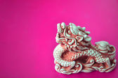 Famous chinese dragon isolated on violet — Stock Photo