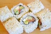 Delicious rolls and sushi with cucmber, salmon and philadelphia — Stock Photo