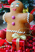 Christmas tree and a cookie man made of ginger bread — Stock Photo