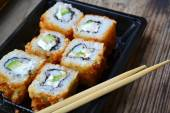 Delicious rolls and sushi with shrimp, cucumber and philadelphia — Stock Photo