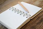 An empty retro notebook with old paper and little pencil — Stock Photo