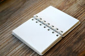 An empty retro notebook with old paper on wooden table — Stok fotoğraf