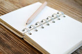 An empty retro notebook with old paper and little pencil — ストック写真