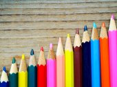 Set of colorful pencils on wooden table — Stock Photo