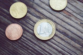 Euro coins on wooden table — Stock Photo