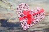 Pink handmade heart with red ribbon bow for St Valentine's Day — Stock Photo
