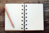 An empty retro notebook with old paper and little pencil — Stock fotografie