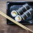 Delicious rolls and sushi with salad, salmon and philadelphia — Stock Photo #63803231