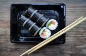 Delicious rolls and sushi with salad, salmon and philadelphia — Stock Photo